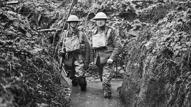 soldiers in flooded trench