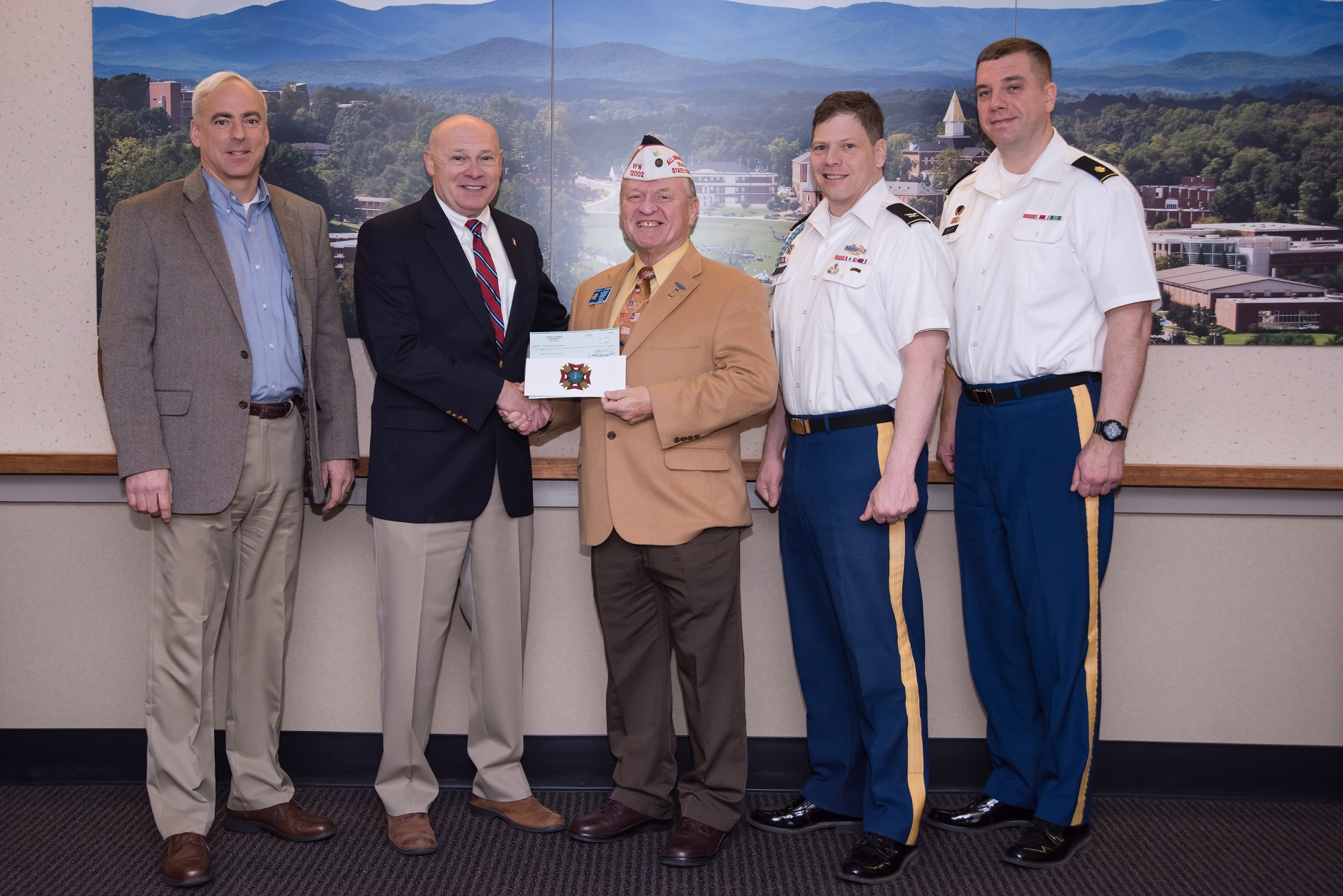 Al Lipphardt, former state commander of the VFW Department of Georgia, (center) presenting a $10,000 donation Feb. 3 to Dr. Billy Wells, senior vice president for leadership and global engagement at the University of North Georgia and chairman of the GWWICC (second from left). Also pictured are (left to right) Keith Antonia, associate vice president for military programs at UNG; Army Col. Gery Cummings, professor of military science; and Army Maj. Steven Devitt, executive officer of UNG's Department of Military Science.
