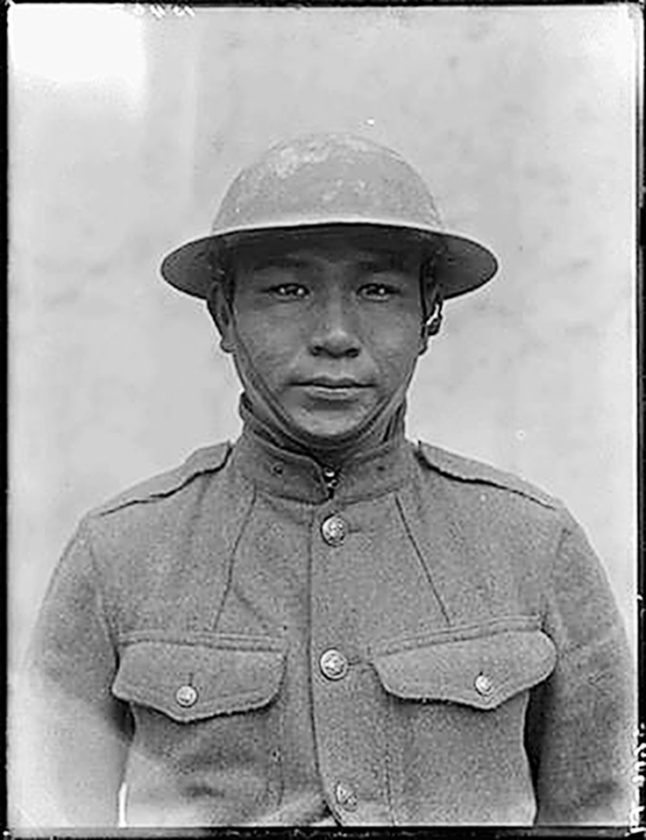 "Private 1st Class John Elk of Standing Rock Reservation in 1919 served in Company D, 139th Infantry Regiment (35th Division), with several other Native servicemen from tribes in North Dakota. Elk has been posthumously recognized as a code-talker in World War I. His commanding officer said he was an ""exceptionally good scout, was very cool and calm but very quiet."" From ""Warriors in Khaki,"" by Michael and Ann Knudson. Photo from British National Archives."