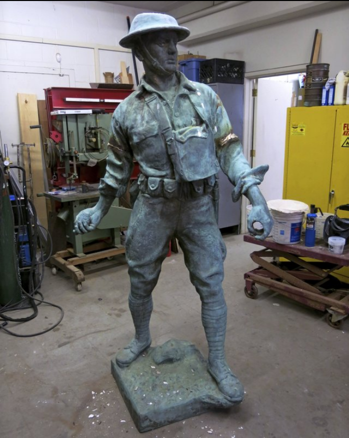 In this March 30, 2016 photo provided by NYC Parks, the World War I Highbridge Doughboy statue is repaired at the NYC Parks monument repair facility in the Brooklyn borough of New York. World War I monuments nationwide have been forgotten about and fallen into disrepair. The centennial of America's involvement in World War I has drawn attention to the state of disrepair of many monuments honoring soldiers, galvanizing efforts to fix them. (NYC Parks via AP)