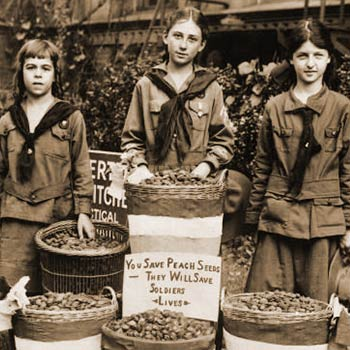 Young girls collecting peach pits used for gas mask