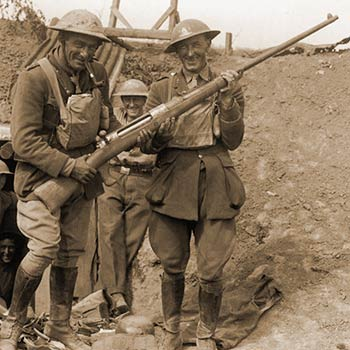 British soldier grin at their captured 1918 Mauser Tankgewehr anti-tank gun
