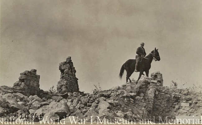 US LOOKING THRU RUINS FOR SNIPERS. MONTFAUCON FRANCE. OCT. 1918 wwimus