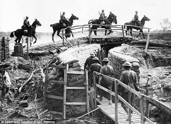 sport and general press agency british cavalry cross trench bridge