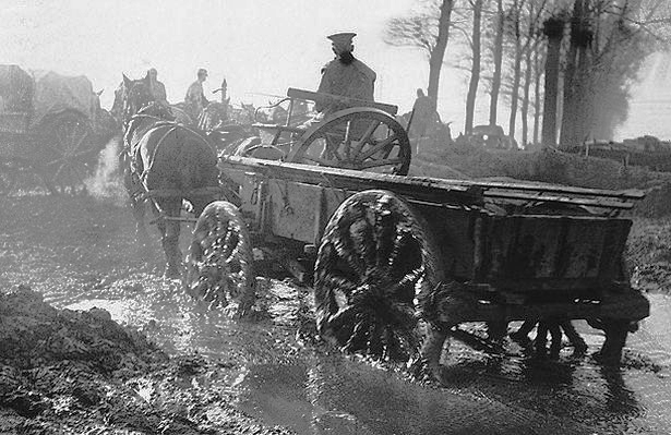 a soldier drives a horse and supply cart through water logged fields and roads pic dm 440860274