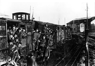 U.S. Doughboys on a French train and 40and8 boxcars