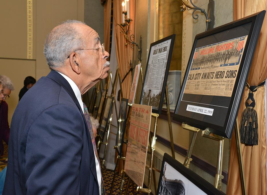guest inspecting display san fran commemoration