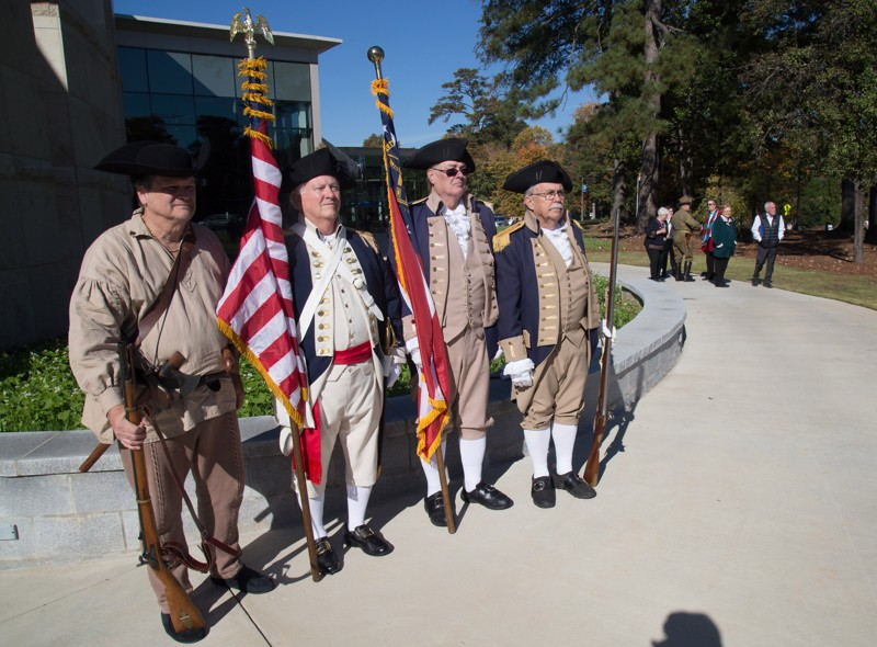 Georgia Society Sons of the American Revolution wait to present the colors before the start of the 2018 Veterans Day Commemoration at the Atlanta History Center on Sunday, November 11, 2018.