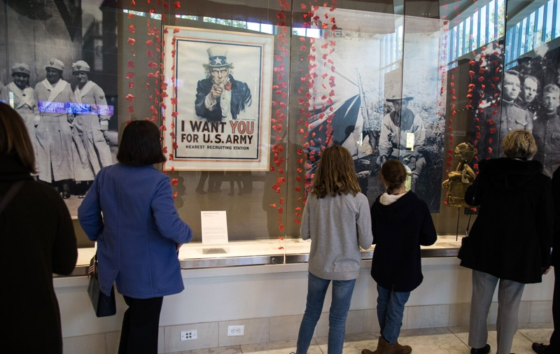 People look over information for the Veterans History Project in the atrium of the Atlanta History Center after the 2018 Veterans Day Commemoration on Sunday, November 11, 2018. (Photo: STEVE SCHAEFER / SPECIAL TO THE AJC)
