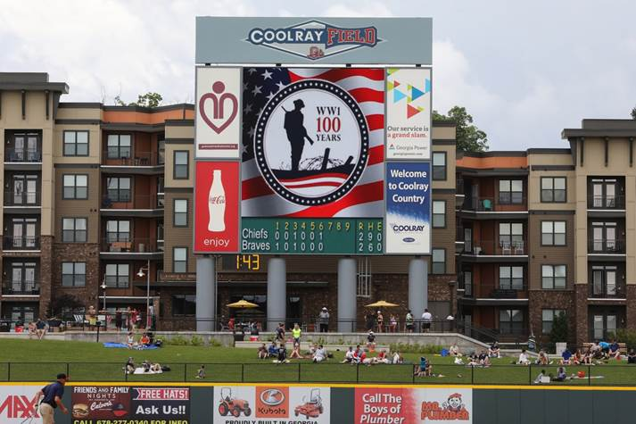 Photograph of CoolRay Field giant screen with picture of World War 1 Centennial Commission seal