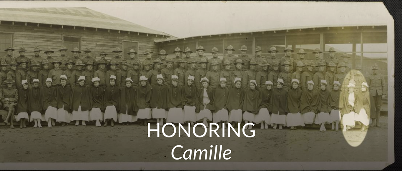 A black and white photo with two rows of soldiers and one row of red cross nurses.  Camille is highlighted with a circle at the far right second from last.