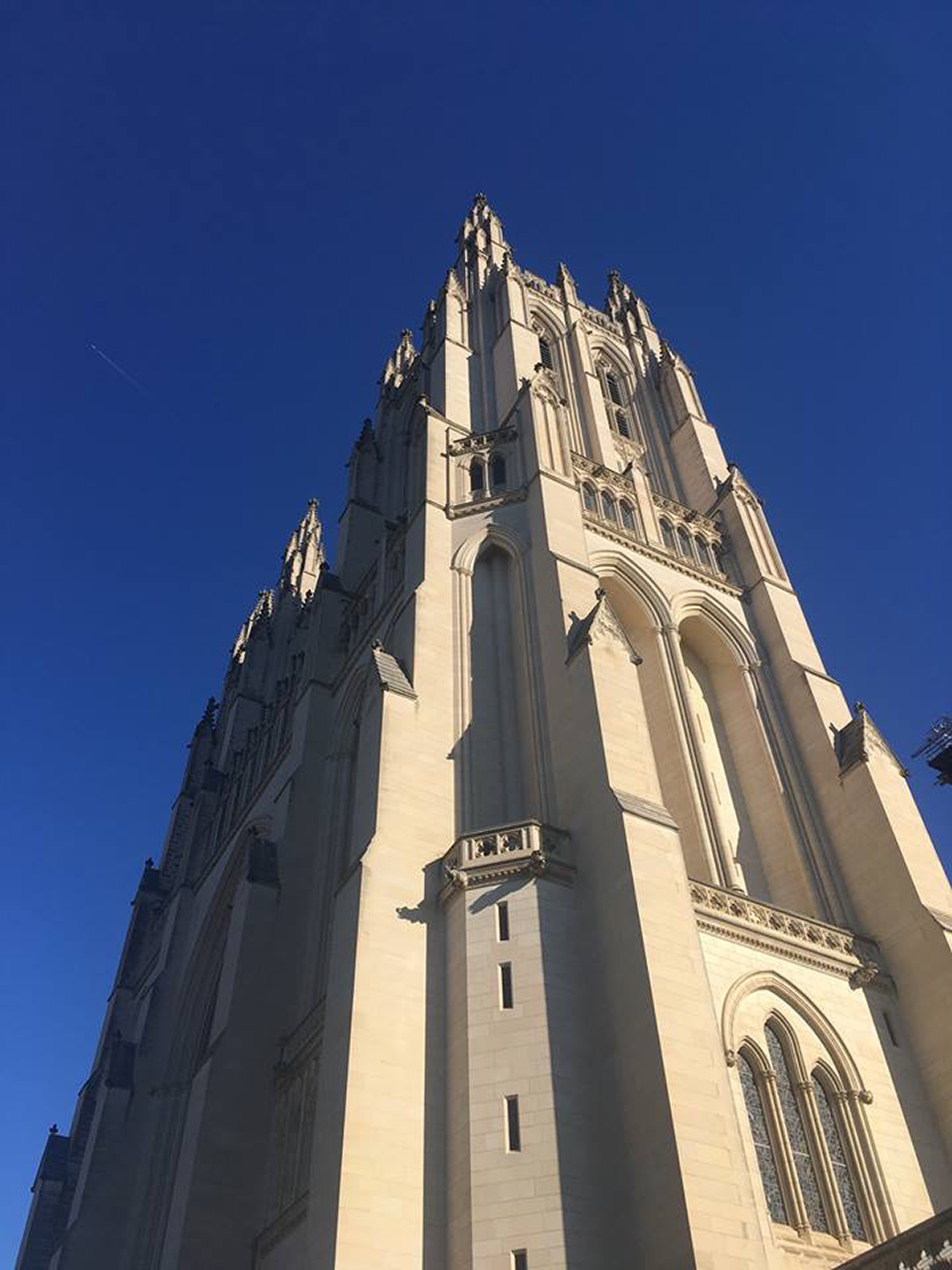 Photo of the outside of the cathedral.  The photo is take from the ground looking all the way up to the top of the very tall cathedral.