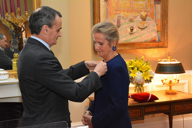 France's Ambassador to the United States, Gérard Araud, pins The Legion d'Honneur onto U.S. World War I Centennial Commissioner Monique Seefried