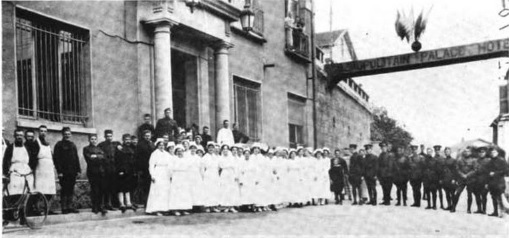 Personnel of Hospital A pose for a photograph outside of their hospital, housed in the Cosmopolitan Palace Hotel in Contrexeville, France.