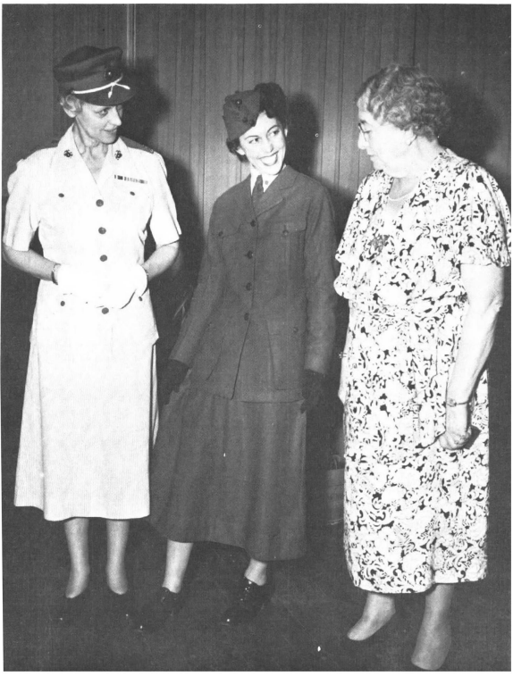 Opha Johnson (far right) and former Director of Women Marines Col. Katherine Towle examine Johnson's original Marine Corps Reserve uniform, as modeled by PFC Muriel Albert circa 1946.