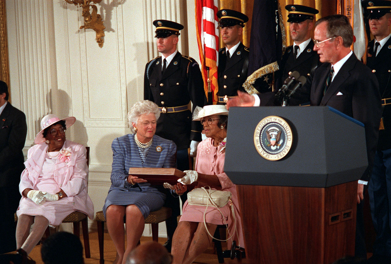 President George H.W. Bush presents the Medal of Honor to relatives of Corporal Freddie Stowers, 1991