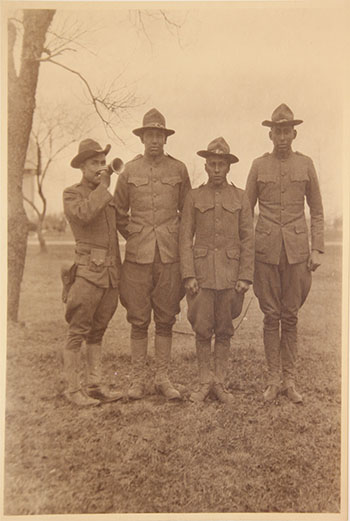 Left to right: Anton Mentag, Stacy SittingHawk, Owen Yakeyonney, and Hezekiah Chebetah. Camp Mills, March 31, 1919. Courtesy of Mathers Museum of World Cultures.