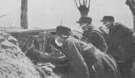 Belgian machine-gunners with rudimentary gas masks, 1915