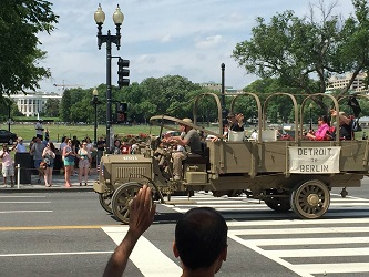 Dave Lockard and Commissioner Edwin Fountain ride in a 15-ton WWI vintage Packard truck during the 2015 Memorial Day Parade in Washington DC.