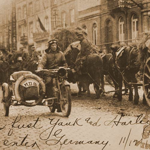 The first American who set foot on German soil 11/12/18, the day after the Armistice was corporal Roy Holtz, US Army entering Germany riding a Harley-Davidson motorcycle and sidecar.